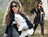 Pregnant Monica Cruz takes her dogs for a scenic walk in Madrid