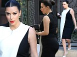 'I dress for my man': Kim Kardashian debuts a new chic maternity-style monochrome shift as she reveals she likes to please Kanye with her outfits