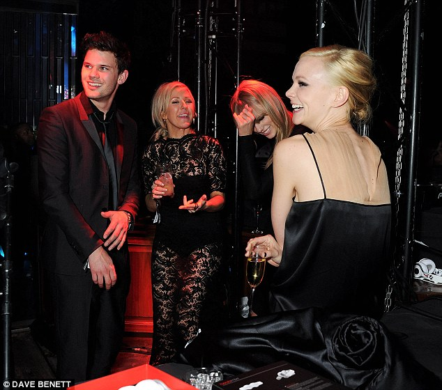 High-profile pals: Carey hangs out with Ellie Goulding, Taylor Swift and Jeremy Irvine at the Soho House bash