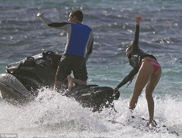 Be careful: The singer nearly fell off her board as they cut through the waves