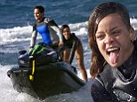 Surf's up! Bikini-clad Rihanna roars around on the back of a jet-ski driven by pro surfer Makua Rothman as she continues to celebrate her 25th birthday