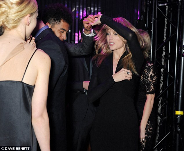Letting her hair: Taylor dances with Jordan Stephens of the Rizzle Kicks while Carey Mulligan looks on
