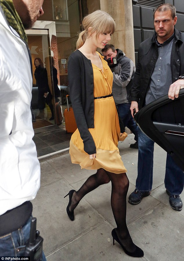 Bright and breezy: Taylor Swift returns to her girl-next-door image as she heads out the morning after partying at post-Brits bash
