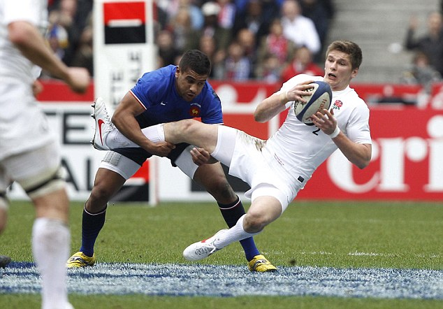 Doing the leg work: Wesley Fofana grabs Farrell when the two countries met last year