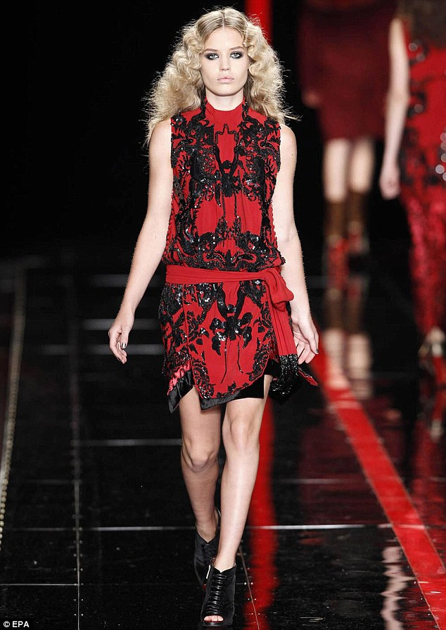 Sashay: Georgia shows off a red and black dress from Cavalli's autumn/winter collection