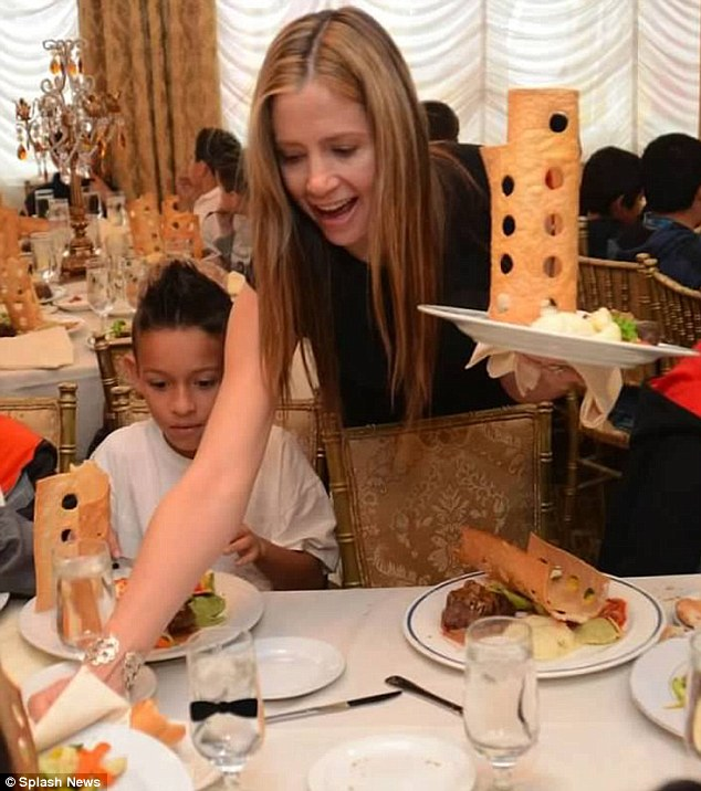 Role model: Mira Sorvino served food to homeless children at the Anaheim White House on Tuesday in Orange County, CA