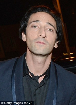 Leading men: Adrien Brody and Michael Moore brought their celebrity weight to the evening