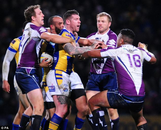 Feisty: Tempers flare between Leeds Rhinos' Brett Delaney (centre) and Melbourne Storm's Siosaia Vave (right)