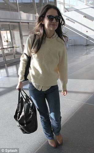 Made for traveling: Katie wore cowboy boots with bootleg jeans for her coast to coast journey