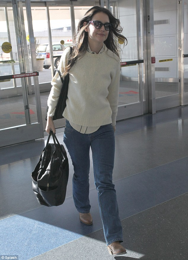 Who needs bags? Katie traveled light for her flight out of New York