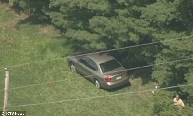 Crime scene: Ballman's body was found in her car, pictured, in a wooded area near New Albany on August 1