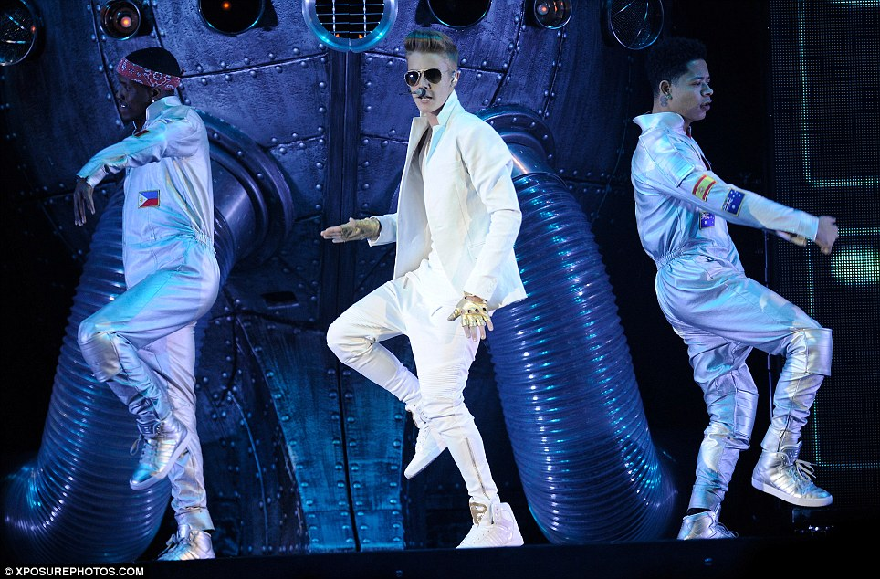 He's got the moves: Justin performs a number of routines while belting out his best known hits, the night after living it up in London with a series of mystery girls