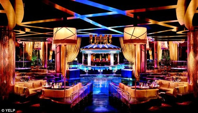 Lavish lifestyle: The football star dropped thousands of dollars on bottles of vodka and champagne at the Las Vegas club on Superbowl Sunday
