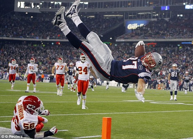 You're out: The tight end, pictured in 2011, is a star player for the Patriots but is out injured