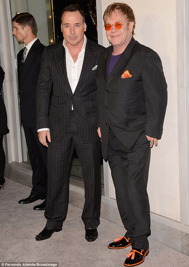 Suited and booted: Elton John and partner David Furnish