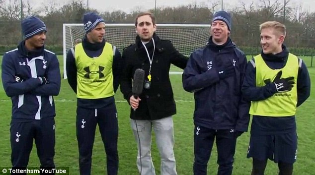 Pressure: Lewis Holtby (right) and Steffen Freund (second right) took on Kyle Walker (second left) and Kyle Naughton before the penalty shootout