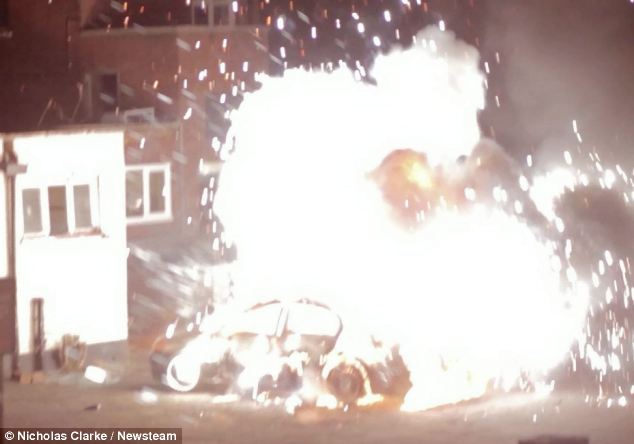 A shower of flames and sparks explodes into the air as the car is dramatically destroyed
