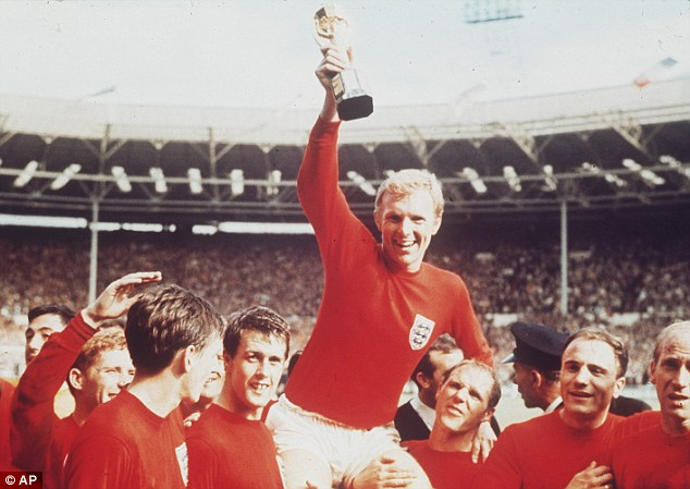 Icon: Bobby Moore is held aloft by the England players as he holds the World Cup in 1966