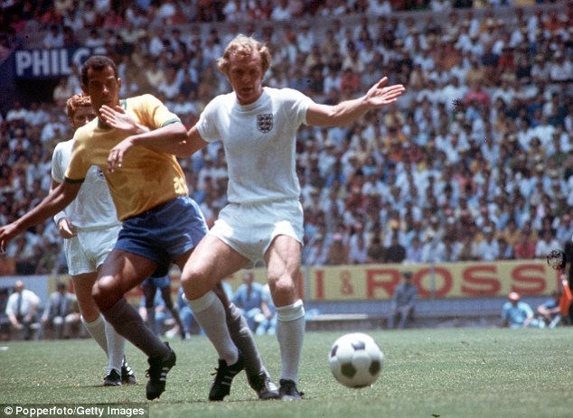 All white: Moore keeps the ball away from Brazilian captain Carlos Alberto in the 1970 World Cup