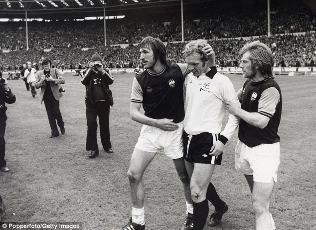 Friends and foes: Billy Bonds came up against Moore in the 1975 FA Cup final when he was playing for Fulham