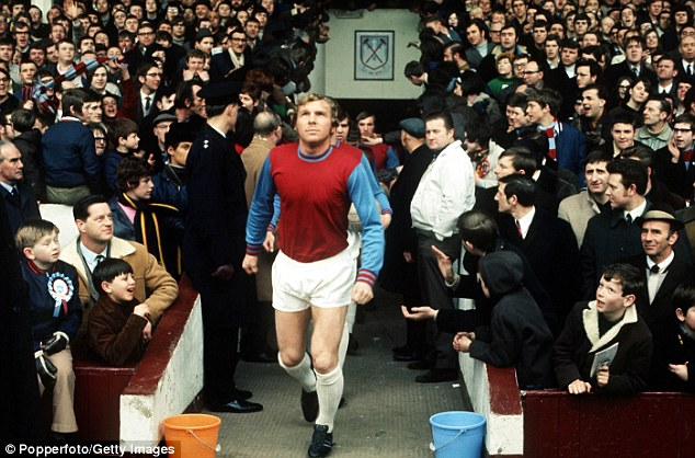 Leader: Moore leads West Ham out at Upton Park