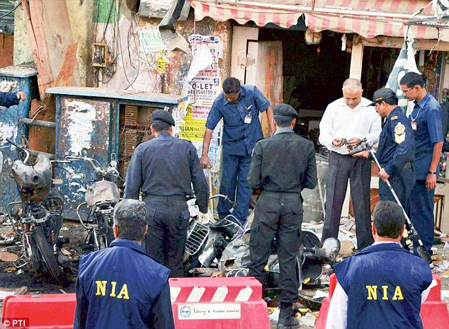 Investigating agencies collecting samples after the twin blast occurred at Dilsukhnagar in Hyderabad