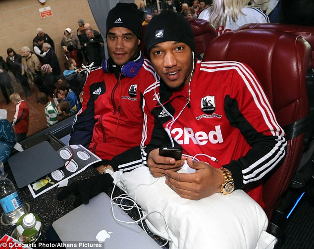 Say cheese: Michel Vorm and Jonathan de Guzman (right) pose for the camera on their way to Wembley
