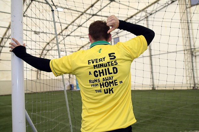 Doing their bit: Norwich boss Chris Hughton and captain Grant Holt show their support for Railway Children