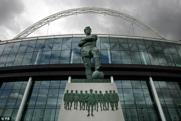 Tribute: Moore's statue stands proudly outside the new Wembley Stadium