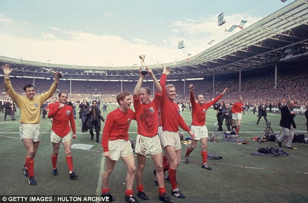 Captain marvel: Moore is held aloft by his team-mates after England won the World Cup in 1966
