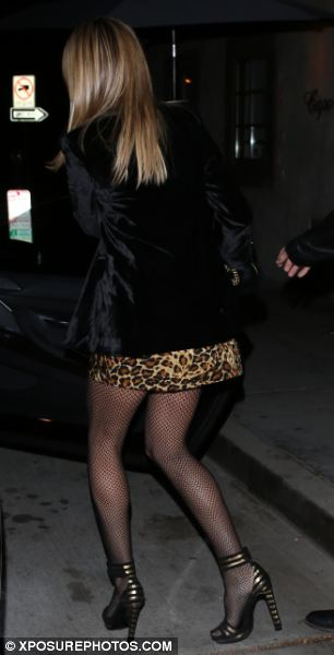 Perfect pins: The German-born model flashed her amazing legs in a leopard print mini dress