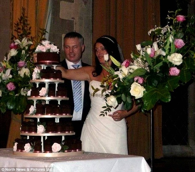Cutting the cake: There were 120 guests at the wedding in March 10 last year, at Redworth Hall Hotel, near Darlington