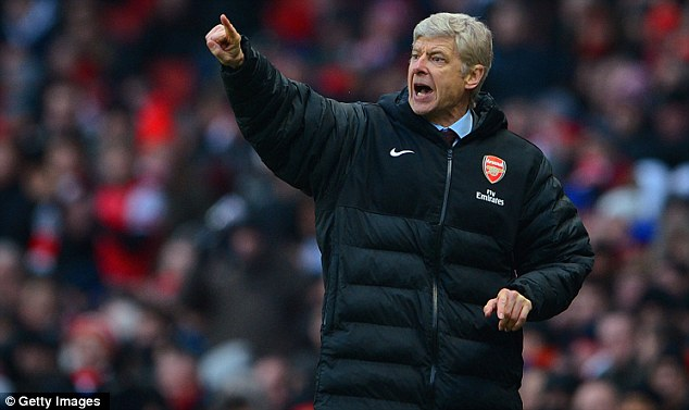 Making his point: Arsene Wenger is confident Arsenal can still qualify for the Champions League
