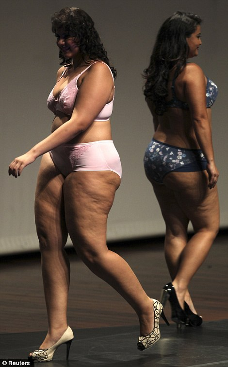 Models walk the runway during a