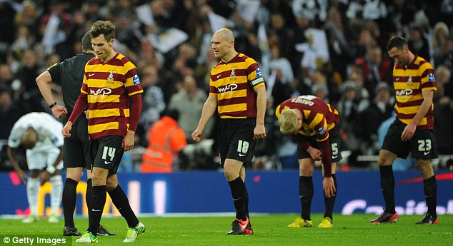 Gutted: Bradford crumbled at Wembley as Swansea turned in a five-star performance