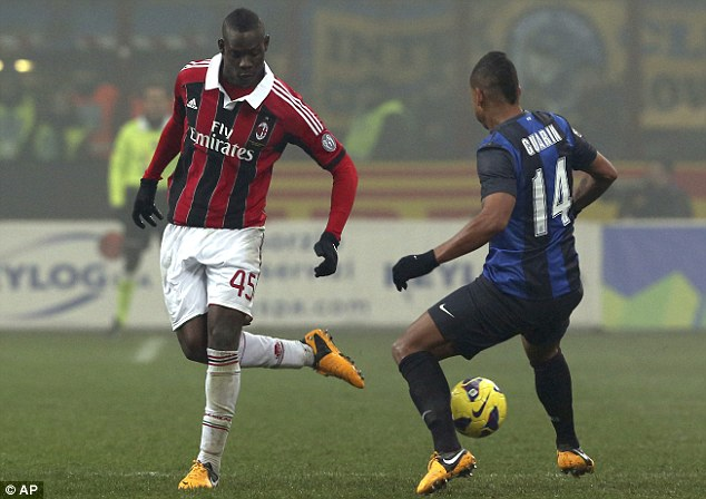 Flicks and tricks: Mario Balotelli (left) was in action in the Milan derby at the San Siro on Sunday