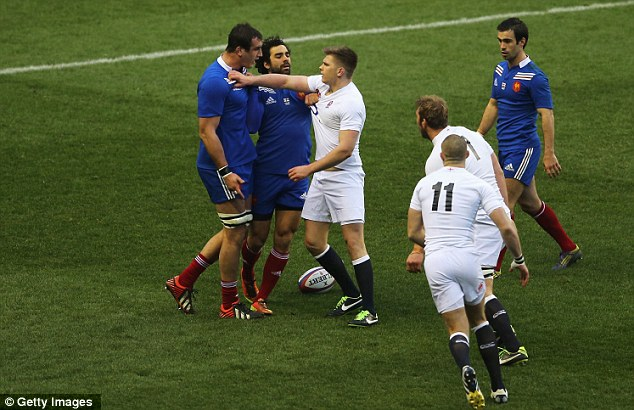 Putting the boot in: Farrell kicked 12 points to help England overcome France in a feisty 'Le Crunch'