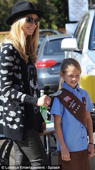 Hats off: Heidi helped supervise little Leni as she helped raise money for her scout troop