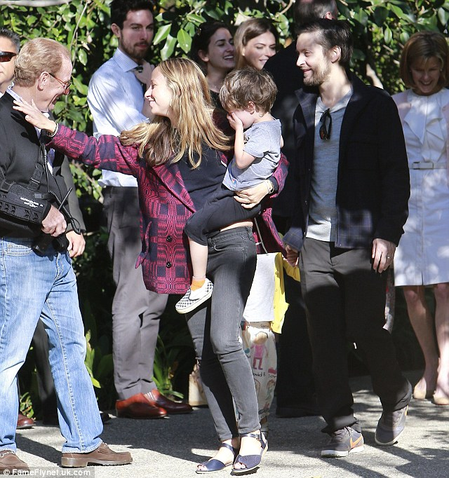 Wave goodbye: Tobey Maguire and wife Jennifer and their son Otis looked in good spirits as they left the bash