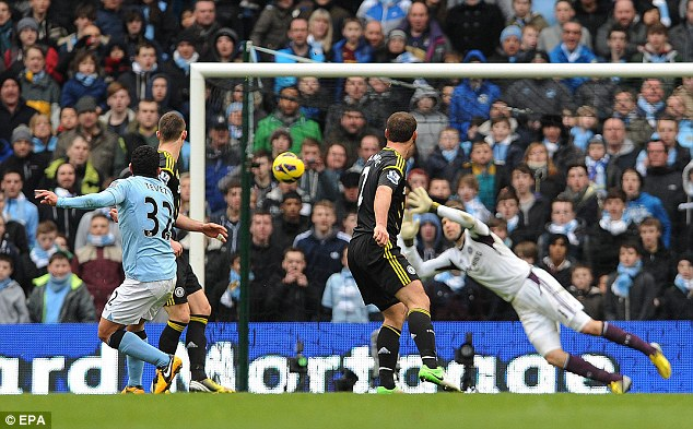 No stopping that: Tevez's shot arrows straight into the top corner of Petr Cech's goal