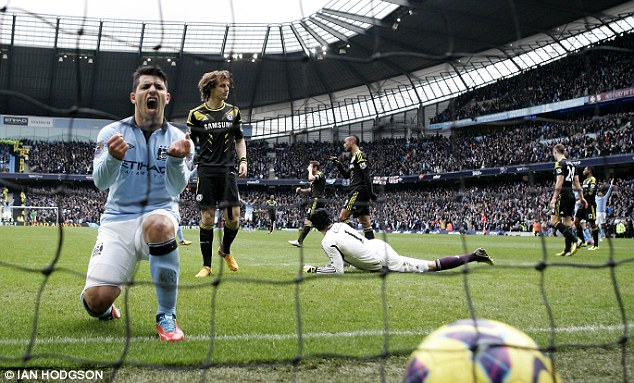 Roar of delight: Aguero shows just what the win means to City as the striker celebrates Tevez's goal