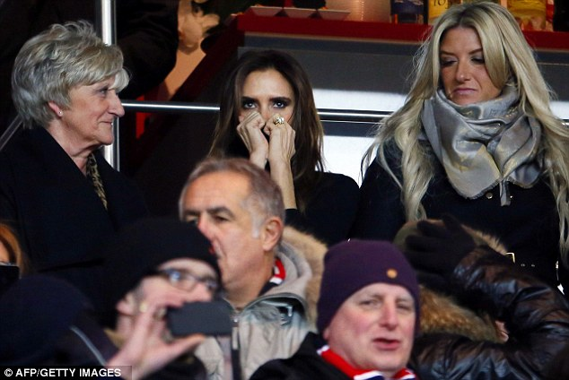 Nail biting stuff: Victoria dramatically hid her face as she watched David in the last 15 minutes of the match alongside his mother and sister
