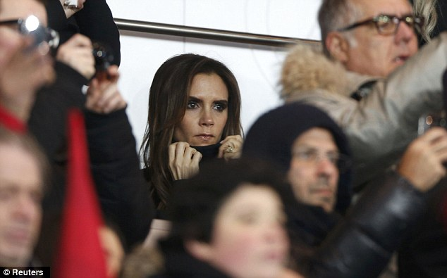 Pat on the back: She had travelled back to Paris especially to support David during the match