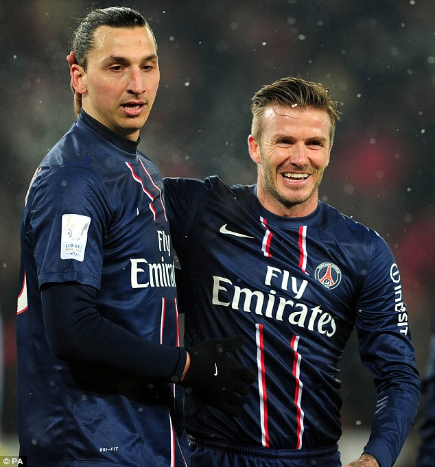 That smile says it all! Beckham was congratulated by Zlatan Ibrahimovic as they completed the game in the pouring rain
