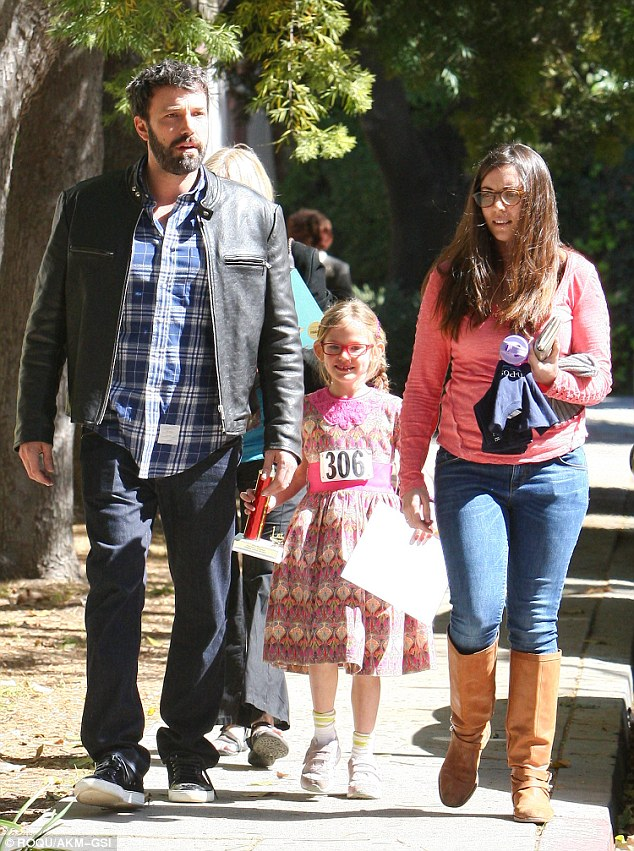 Chip off the old block: Ben Affleck was the proud papa after daughter Violet won a trophy at a spelling bee Sunday morning