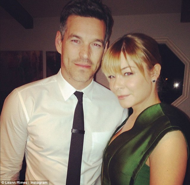 Getting in on the act: While Brandi was posing on the red carpet, her ex-husband spent the night with LeAnn Rimes; LeAnn tweeted 'My hot date tonight.... Love him!'