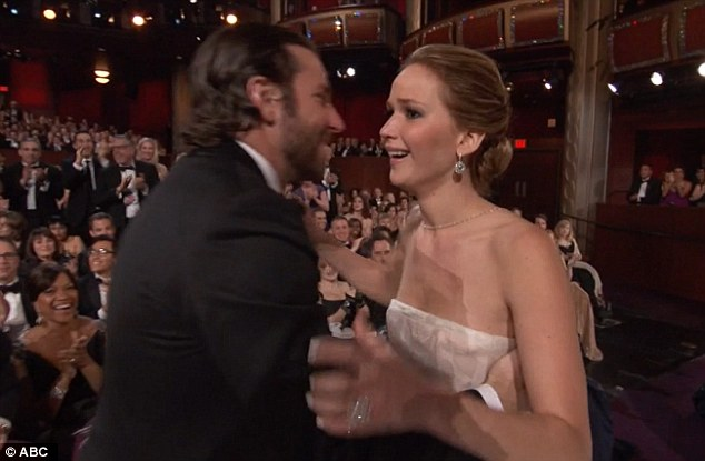 Delighted: Shocked Jennifer is congratulated after she is announced as Best Actress