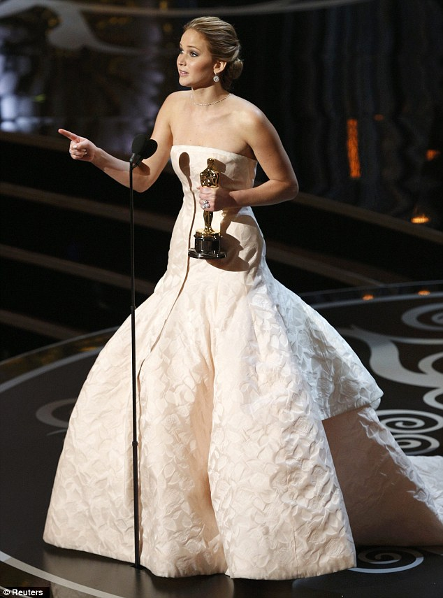 So embarrassed: Jennifer thanks the audience for their standing ovation as she accepts the Best Actress Oscar