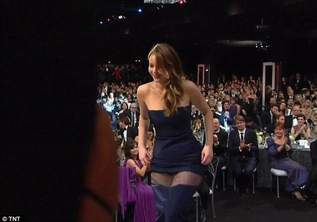 Not again: Jennifer's dress appeared to rip as she climbed the stage at the SAG Awards, although Dior later explained that it was simply the way it was made