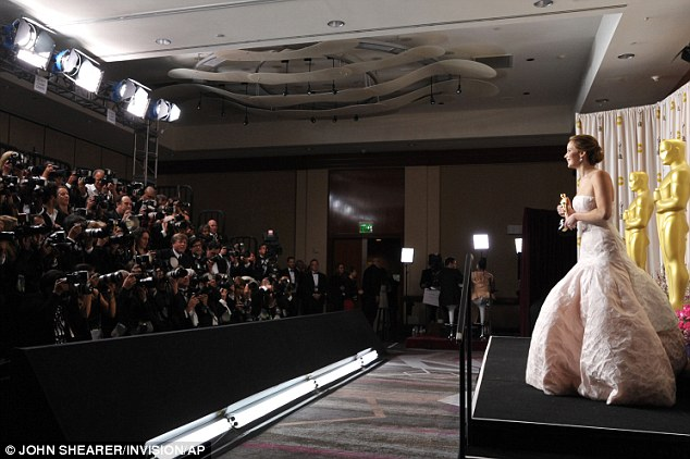 Facing the cameras: The young actress, just 22 years old, has the film world at her feet after her stunning turn in Silver Linings Playbook